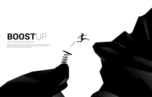 Silhouette of businesswoman jump over the gap with springboard