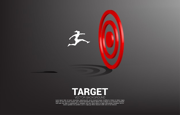 Silhouette of businesswoman jump to target dartboard. concept of vision mission and goal of business