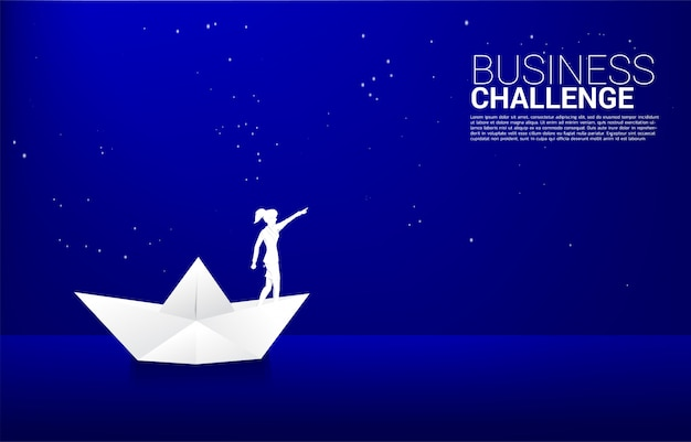 Silhouette of businesswoman in paper ship origami point to star in the sky at night. concept of route to success. goal mission vision success in career path.