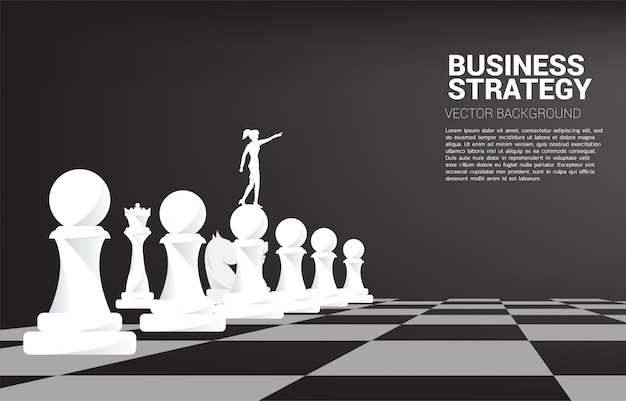 Silhouette of businesswoman point forward with chess piece. concept of business strategy marketing.
