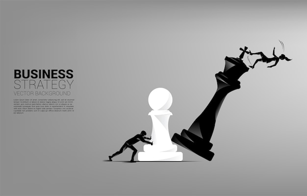 Silhouette of businesswoman push pawn chess piece to checkmate the king with falling down businessman.