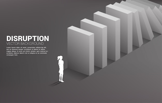 Silhouette of businesswoman standing at the end of domino collapse. concept of business industry disrupt