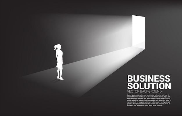 Silhouette of businesswoman standing in front of exit door background