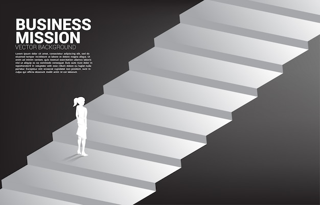 Silhouette of businesswoman standing on stair