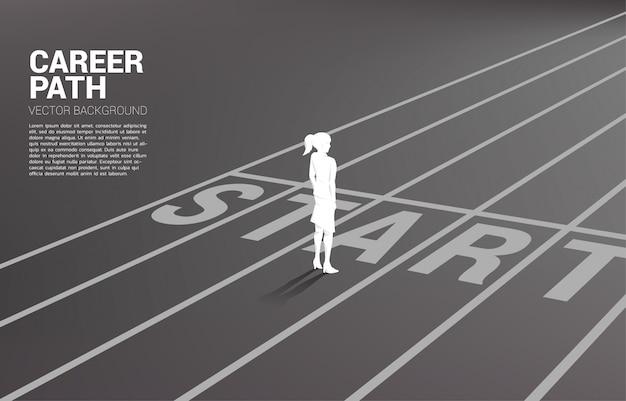Silhouette of businesswoman standing at start line