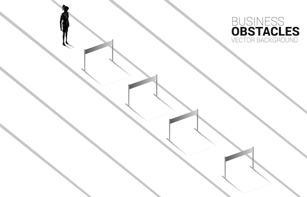 Silhouette businesswoman standing with hurdles obstacle. background concept for obstacle and challenge in business