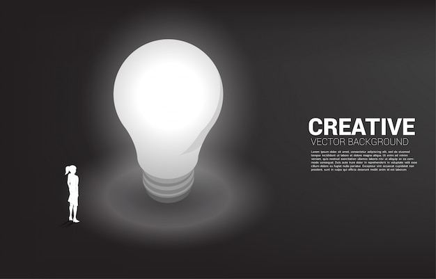 Silhouette of businesswoman standing with light bulb . business concept of creative idea and solution.