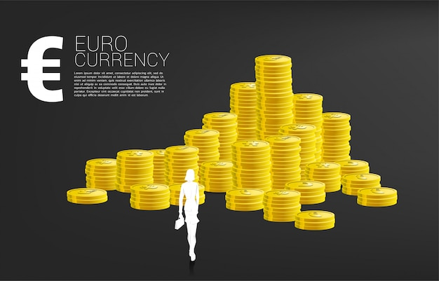 Silhouette of businesswoman with the briefcase standing in front of euro money and stack of coin. concept of success business and euro zone economy.