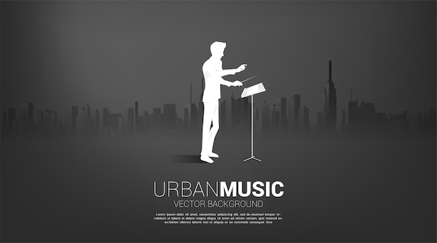 Silhouette of conductor standing with city background. concept for city of music.
