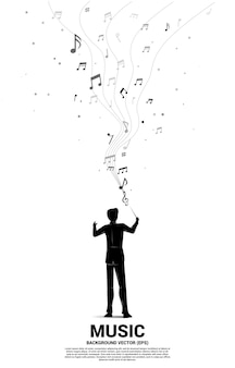 Silhouette of conductor standing with flying music note. concept background for orchestra concert and recreation.