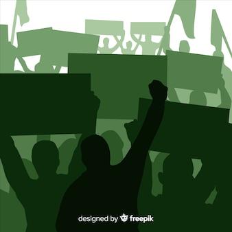 Silhouette folla di persone con bandiere e striscioni in una manifestazione Vettore gratuito