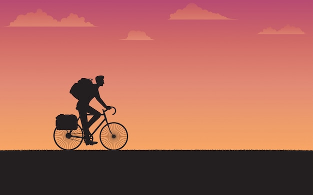 Silhouette cyclist traveler
