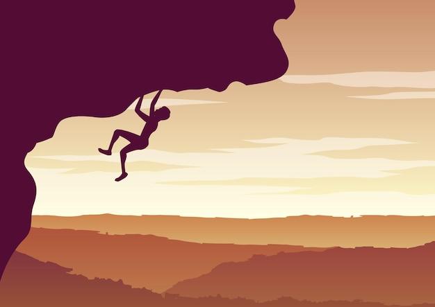 崖を登る男のシルエットデザイン