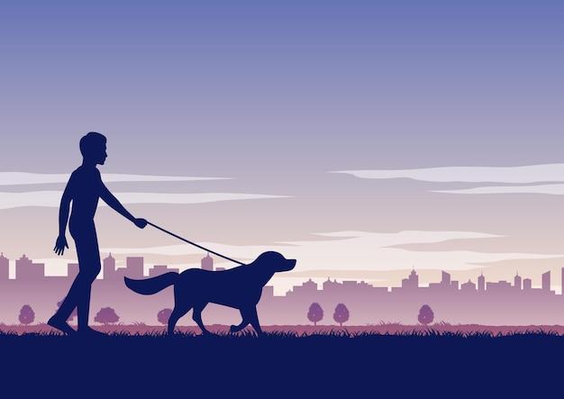 男のシルエットデザインは犬を歩く