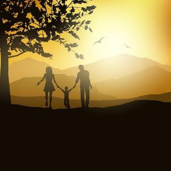 Silhouette di una famiglia a piedi di fuori della campagna