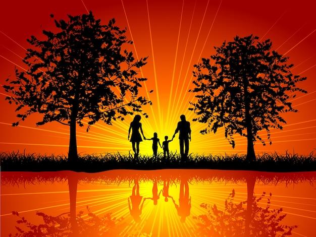 Silhouette di una famiglia che cammina fuori sotto gli alberi