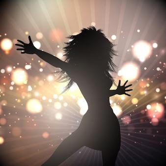 Silhouette di una danza femminile su uno sfondo di luci astratta