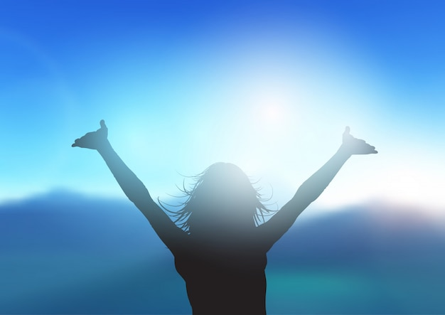 Silhouette of female with arms raised against mountain landscape