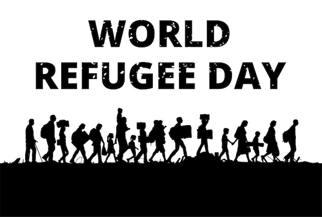 Silhouette of a group of refugees walking through a field
