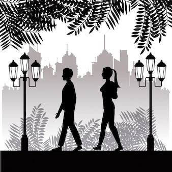 Silhouette guy and girl walk park town background