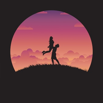 Silhouette happy couple in love with sunset