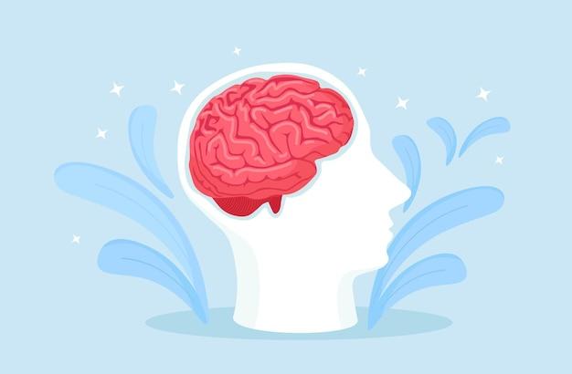 Силуэт головы с человеческим мозгом. неврология, концепция психологии