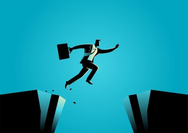 ビジネスマンのシルエットイラストが峡谷を飛び越えます。挑戦、障害、楽観主義、ビジネスコンセプトの決意