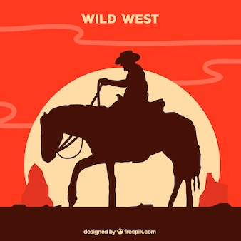 Silhouette of lone cowboy riding