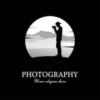 Silhouette male photographer looking at the camera