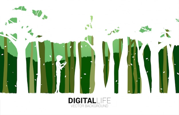 Silhouette of man use mobile phone in green park. concept for digital life with natural