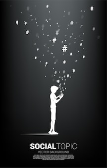 Silhouette of man use mobile phone and hash tag flying . background concept for social topic and news.