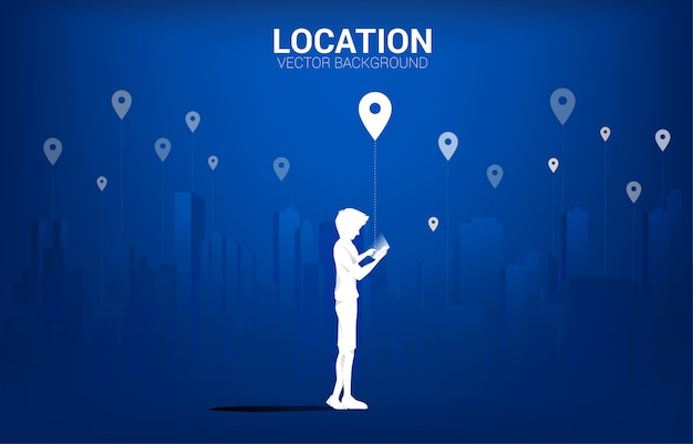 Silhouette of man with mobile and gps icon with city background. concept of location and facility place , gps technology