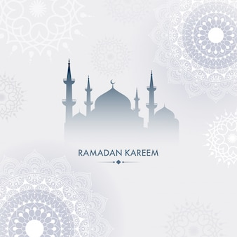 Silhouette of a mosque and mandala floral pattern on grey background.  ramadan kareem concept.