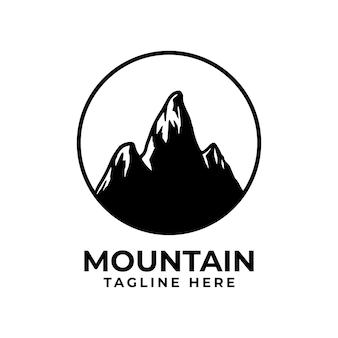 Силуэт горы логотип с кругом. горный вектор дизайн для символа приключений