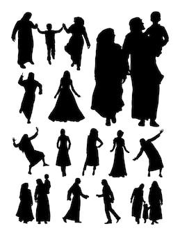 Silhouette of muslim family