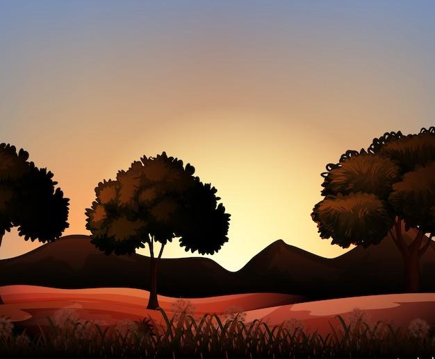 Сцена природы силуэта с полем и деревьями