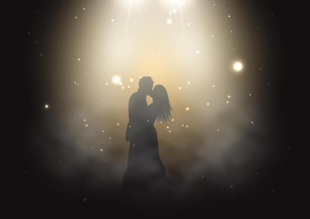 연기가 자욱한 분위기에서 스포트라이트 아래에서 춤추는 신부와 신랑의 실루엣