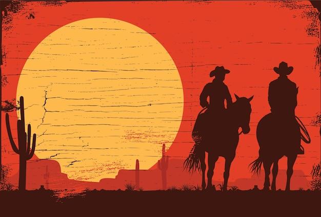 Силуэт ковбоев на лошадях