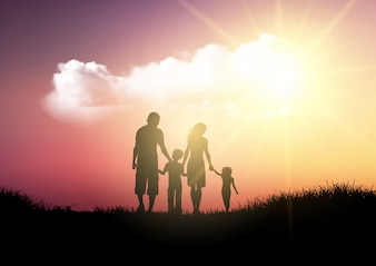 Silhouette of a family walking against a sunset sky