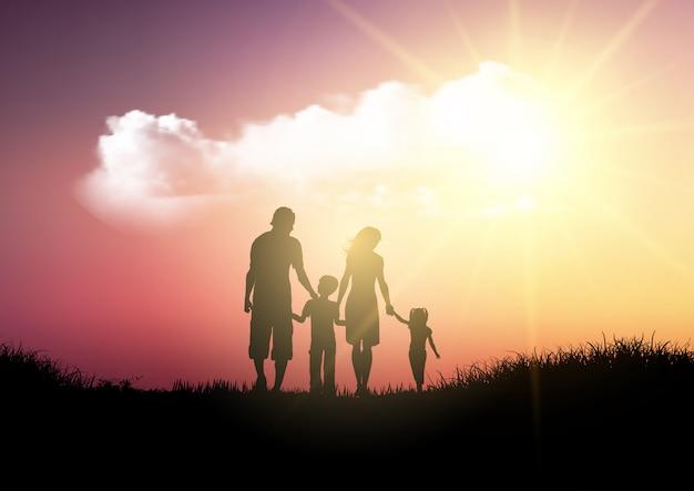 日没の空を歩く家族のシルエット
