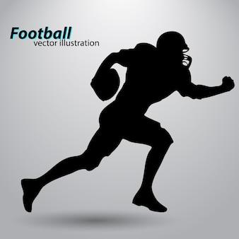 フットボール選手のシルエット。ラグビー。アメリカンフットボール選手