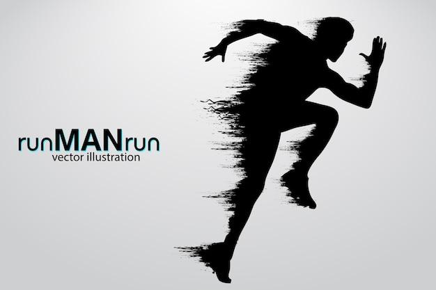 走っている男のシルエット。図