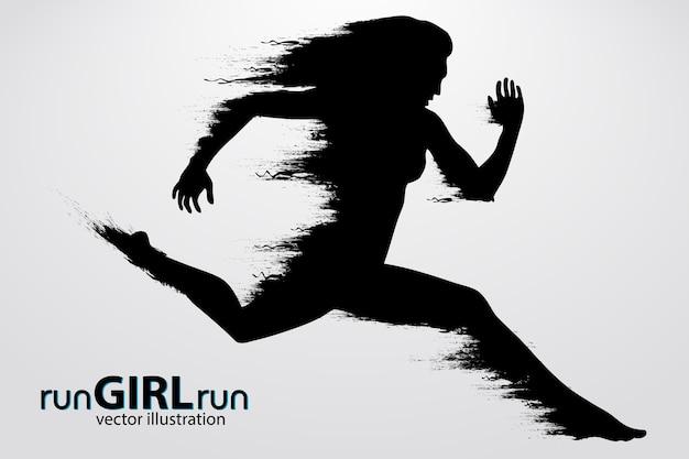 走っている女性のシルエット。図