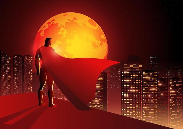 밤 풍경이 있는 건물 가장자리에 서 있는 슈퍼히어로의 실루엣