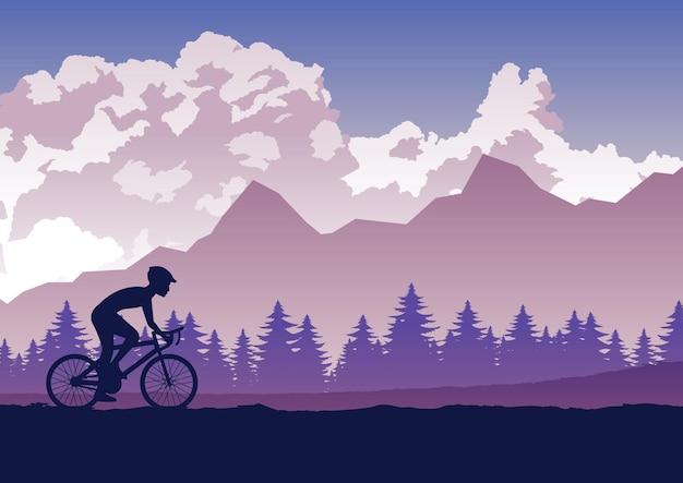 自転車で運動する人々の活動のシルエットが森を通過