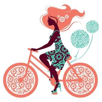 자전거에 아름 다운 여자의 실루엣