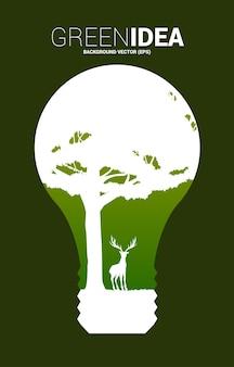 큰 사슴과 전구에 나무의 실루엣. 녹색 아이디어에 대한 배경 및 환경을 저장합니다.