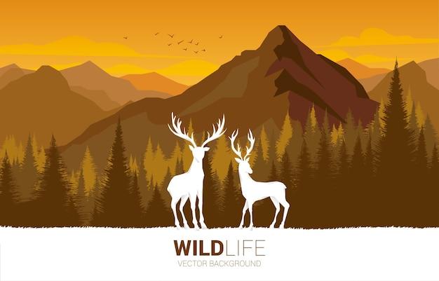 森と山を背景に大きな鹿のシルエット。自然のために世話をし、環境を保存します。