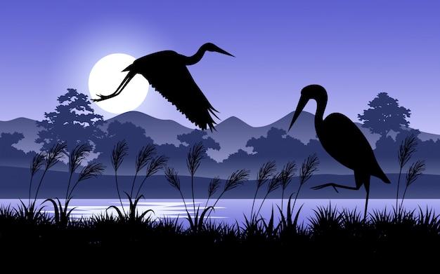 日の出の間に森の鳥のシルエット