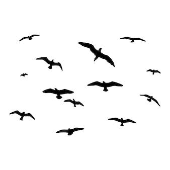 鳥のシルエット空の孤立した背景の鳥のベクトルの群れ